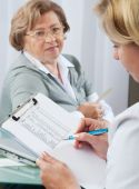 stock photo of doctors office  - Doctor examines results of blood tests - JPG