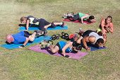 foto of rep  - Bootcamp fitness trainer coaching diverse class outdoors - JPG