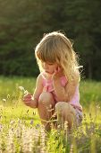 Beautiful Little Girl Playing In Nature