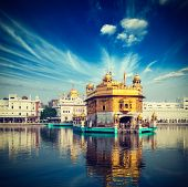 stock photo of harmandir sahib  - Vintage retro hipster style travel image of famous India attraction Sikh gurdwara Golden Temple  - JPG