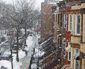 stock photo of brownstone  - View of Brownstone Brooklyn row houses in winter with heavy snowfall - JPG