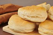 picture of buttermilk  - Fresh baked buttermilk biscuits on a cutting board with a towel - JPG