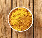 stock photo of garam masala  - overhead view of bowl with curry powder - JPG