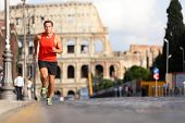 Running runner man by Colosseum, Rome, Italy. Male athlete training for marathon jogging in city of