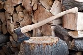 foto of ax  - a big old ax with fire wood - JPG