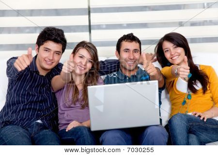 Happy Group With A Laptop