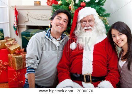 Happy Couple With Santa Claus