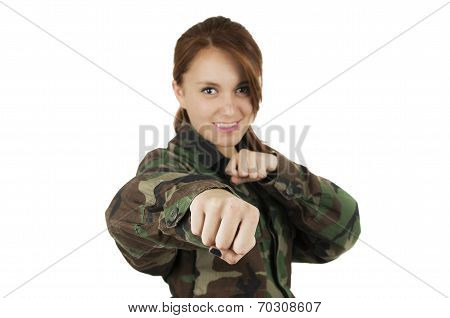 Beautiful youngcontent  teenage girl wearing military jacket showing fist