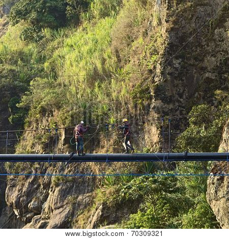 Working on Pipe Near Banos, Ecuador