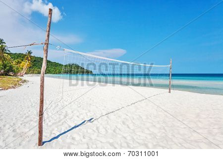 Volleyball net on an empty tropical  beach