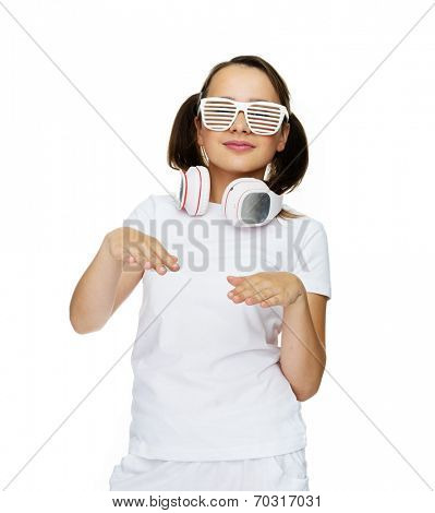 Hip young girl with her hair in pigtails wearing shutter sunglasses and a headphone around her neck, isolated on white