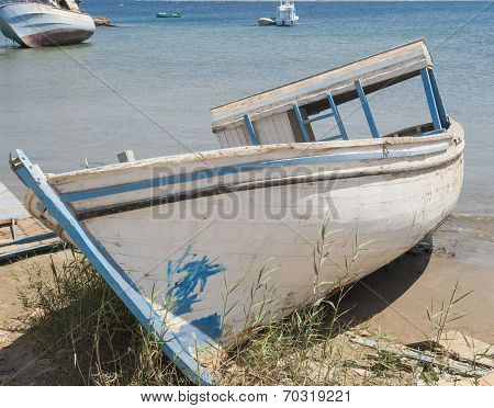 Old Derelict Boat Abandoned On Beach