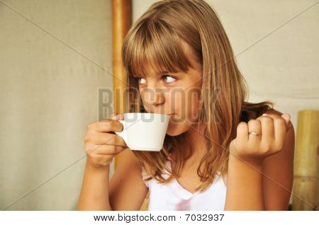 Tanned Girl Drinking Tea