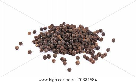 Heap of black spicy peppercorn.