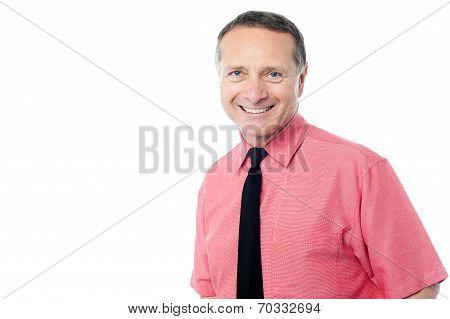Senior Businessman Smiling To Camera
