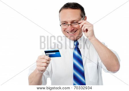 Smiling Executive Holding Credit Card