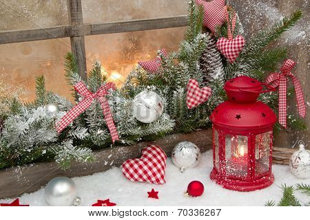 Red Rustic Christmas Decoration On Window Sill With Red Checked Hearts In Country Style