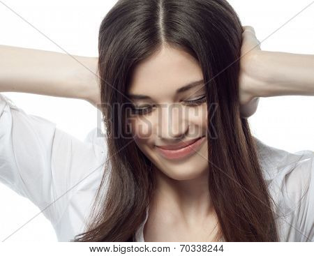 closeup portrait of attractive  caucasian smiling woman brunette isolated on white studio shot lips toothy smile face hair head and shoulders eyes closed ears closed by hands businesswoman