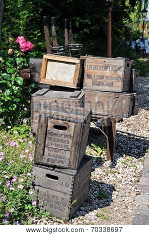 Old wooden crates on railway platform.