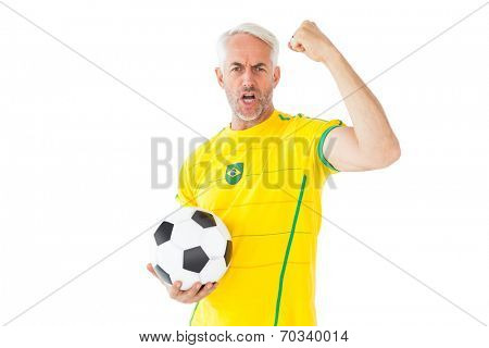 Cheering brazilian football fan in yellow on white background