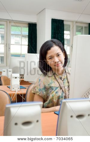 Asian Young Woman In The Computer Classroom