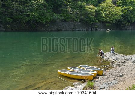 KYOTO, JAPAN - APRIL 26th  : Three canoes docked at the shore of Hozu(Katsuragawa)  River in Arashiyama in Kyoto, Japan on 26th April 2014.