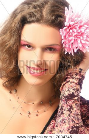 Young Smiling Woman With Pink Flower