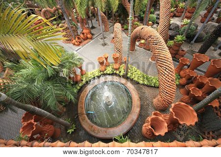 A view from above to fountain and pots in the Nong Nooch tropical botanic garden near Pattaya city i