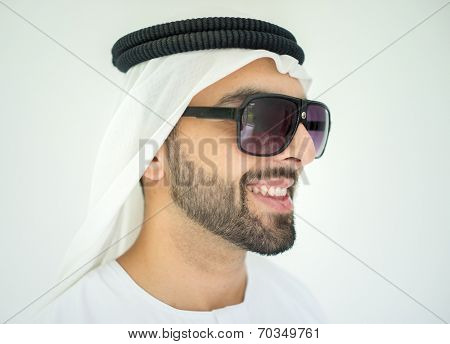 Arabic young man posing with sunglasses
