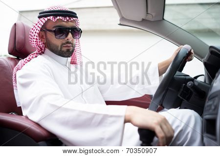Arabic young businessman driving car
