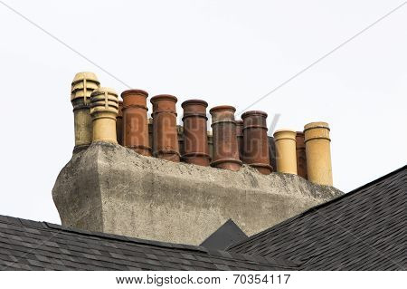 multiple chimneys on row house