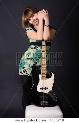 Young Beautiful Girl With A Guitar