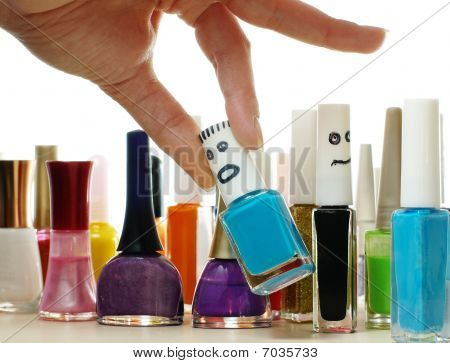 Woman Chooses The Nail Lacquer From Collection