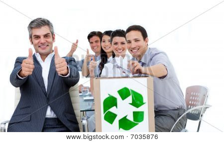 Cheerful Business People Showing The Concept Of Recycling