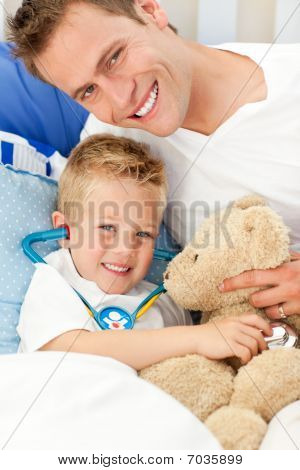 Handsome Father And His Sick Son Playing With A Stethoscope