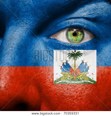 Haitian Flag Painted On A A Man's Face