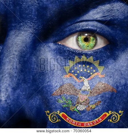 Flag Painted On Face With Green Eye To Show North Dakota Support