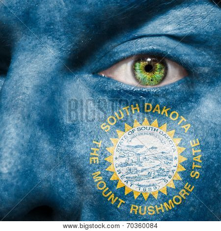 Flag Painted On Face With Green Eye To Show South Dakota Support