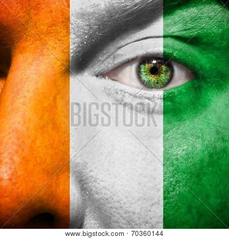 Ivory Coast Flag Painted On A Man's Face