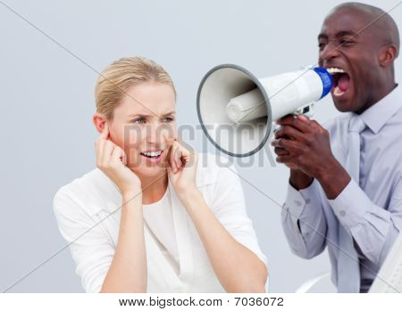Angry Businessman Looking His Colleague's Computer Through Binoculars