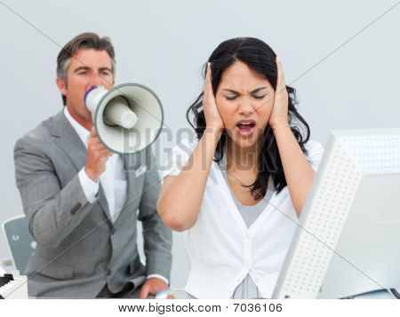 Furious Manager Shouting Through A Megaphone In A Colleague's Ears