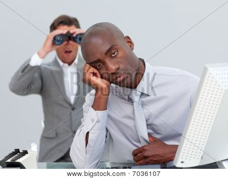 Ethnic Businessman Getting Bored And His Manager Looking Through Binoculars