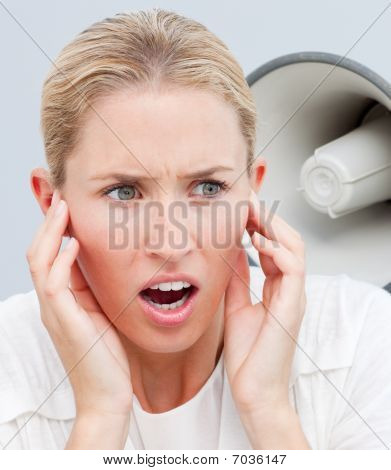 Portrait Of Someone Shouting Through A Megaphone In A Woman's Ears