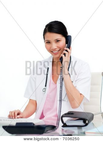 Asian Doctor Talking On Phone
