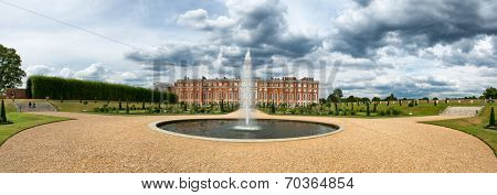 Hampton Court Palace and fountain at Privy Gardens near London