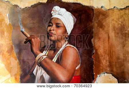 Graffity of Woman wearing a head scarf and traditional jewellery smoking a big fat Cuban cigar with a look of relish and defiance against an old grunge graffiti painted brown wall