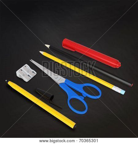 Set Of School Or Office Desk Items On Black Board