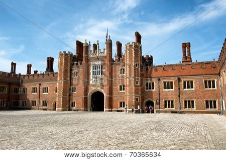 Main Court at Hampton Court Palace. Hampton Court Palace is a royal palace in the London Borough of Richmond upon Thames, Greater London, in the historic county of Middlesex