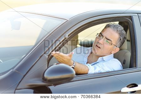 Irritated Male Driving His Car In Traffic - Road Rage Concept