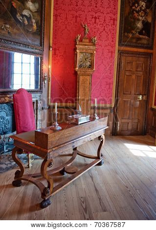 HAMPTON COURT, UK - AUGUST 03, 2014 - Working room with old desk and chair at Hampton Court Palace near London